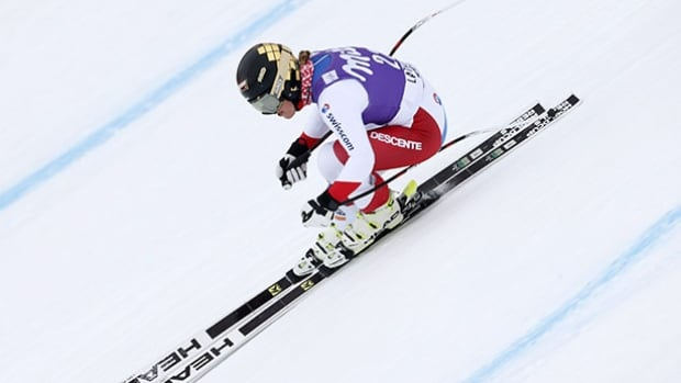Switzerland's Lara Gut speeds down the course Thursday. On Friday the skier overtook American Lindsey Vonn in the overall World Cup rankings.