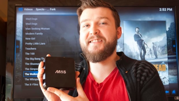 Joel Adams displays one of the devices sold online by his company Android TV Boxes Canada. The box comes with the promise of television with no monthly bills.
