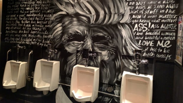 A urinal at a Winnipeg nightclub features a painting of U.S. presidential hopeful Donald Trump.