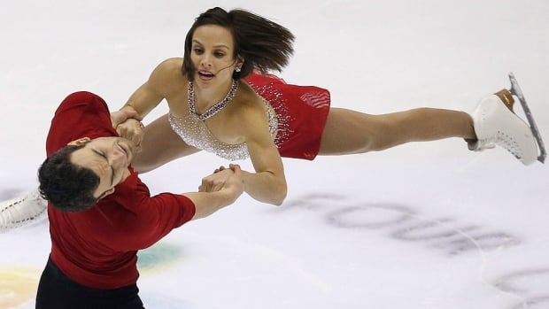 Meagan Duhamel and Eric Radford of Canada, seen here performing their pairs short program at the Four Continents figure skating championships in Taipei, Taiwan, on Thursday, have pulled out of Saturday's free skate because Duhamel has the stomach flu. They sat second to China's Wenjing Sui and Cong Han after the short program.