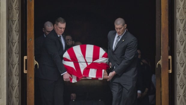 The casket containing the body of the late Supreme Court Associate Justice Antonin Scalia leaves the Basilica of the National Shrine of the Immaculate Conception in Washington following funeral mass services, Saturday.