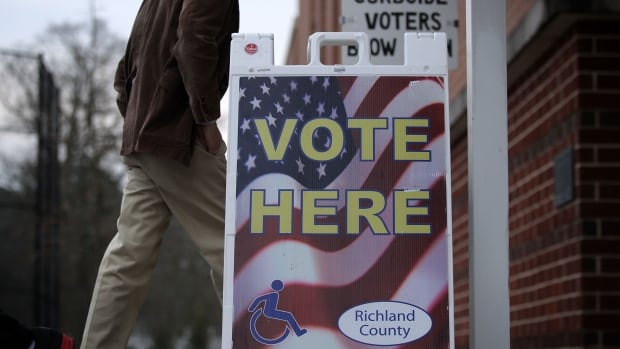 A voter arrives at a polling station in Columbia, South Carolina on Saturday. Residents of South Carolina were picking their candidate in the state Republican primary.