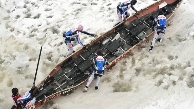 Five-member teams use spiked boots to propel themselves along the ice until they hit open water and can start rowing.