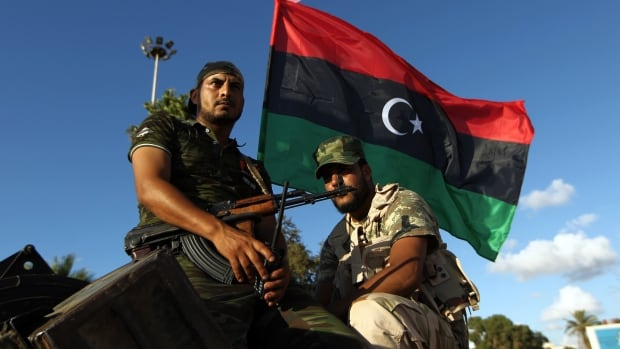 Libyan troops sit on an armoured personnel carrier Aug. 14, 2015 in Benghazi. Libya's second-largest city has seen some of the worst fighting since the 2011 uprising against Moammar Gadhafi.