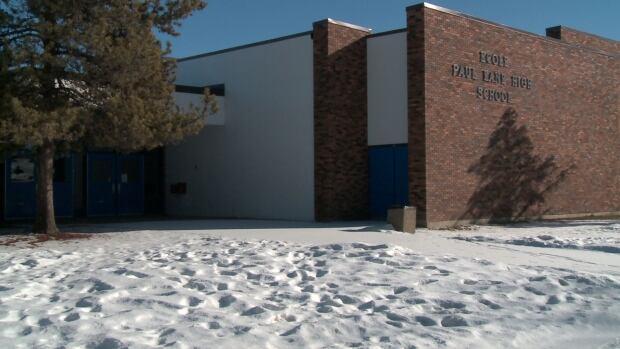 The threat was scrawled in a bathroom at Paul Kane High School.