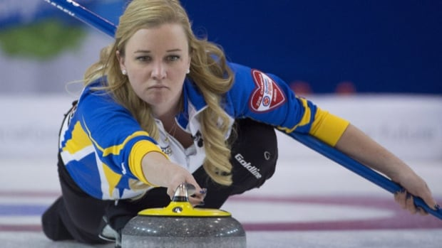 Alberta skip Chelsea Carey makes a shot during the third draw against Newfoundland and Labrador at the Scotties Tournament of Hearts in Grande Prairie, Alta., Sunday. Carey finished the opening weekend a perfect 3-0.