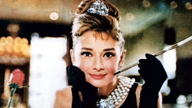 Audrey Hepburn beams in the 1961 film, Breakfast at Tiffany's. The film was game-changer for both the actress and the brand.