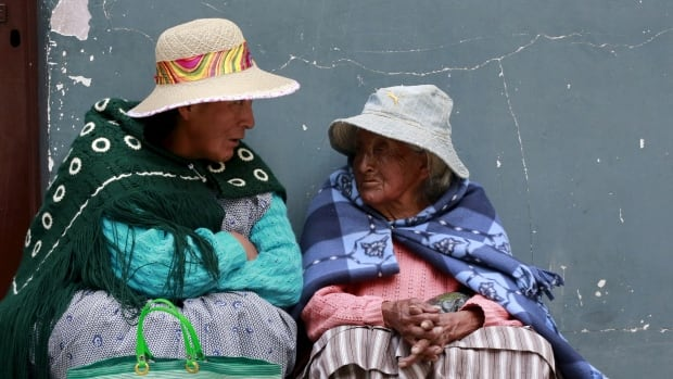 Elderly indigenous women chat at a polling centre during a national referendum in El Alto, on the outskirts of La Paz, Bolivia, on Sunday. Bolivians will decide if President Evo Morales can stay in power for a fourth term.
