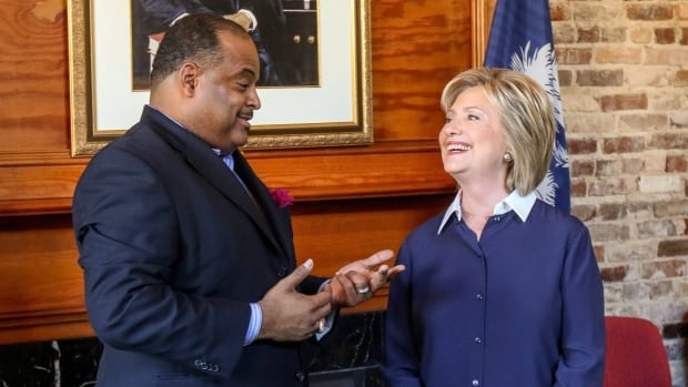 Roland Martin, the host and managing editor of TV One's News One Now, speaks with Democratic presidential candidate Hillary Clinton before a town hall meeting hosted by the South Carolina legislative black caucus in Nov. 2015 at Claflin University in Orangeburg, SC. Next week's South Carolina Democratic primary will be the first to involve a significantly black electorate.