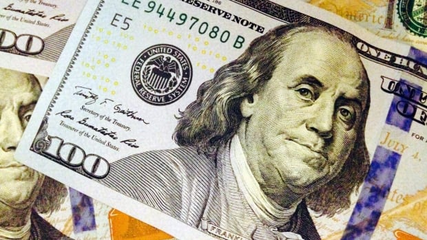 The likeness of Benjamin Franklin is seen in this file photo of a U.S. $100 bill.