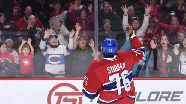 Montreal Canadiens defenceman P.K. Subban tosses souvenir puck to fans at an open practice Sunday at the Bell Centre. The team will discuss the practice of soft-tossing pucks after a baby was struck in the head.