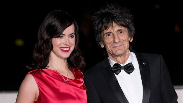 Ronnie Wood said on Twitter that his pregnant wife Sally has not been 'sent home' from Brazil, but she is leaving because the Zika virus is 'too dangerous' for her to stay.