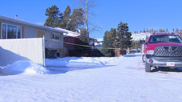 The house where police say a meth lab was discovered over the weekend is cordoned off while members of the Whitehorse fire department investigate the cause of a fire that initially alerted them to the laboratory.