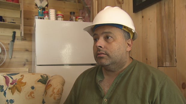 Garry Sanipass, running for chief of the Buctouche MicMac band, says voting restrictions are unfair. Sanipass says he is wearing a hardhat to show he wants to rebuild the reserve.