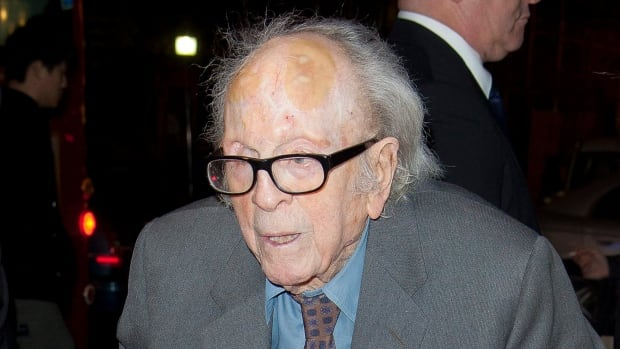 In this Nov. 13, 2011 file photo, British cinematographer Douglas Slocombe arrives for a tribute to Oscar-winning actress Vanessa Redgrave in London.