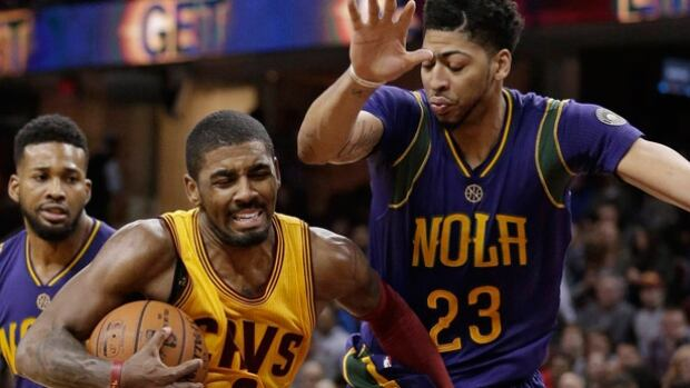 """Cleveland Cavaliers guard Kyrie Irving, middle, says """"It is what it is,"""" after incident involving bed bugs."""