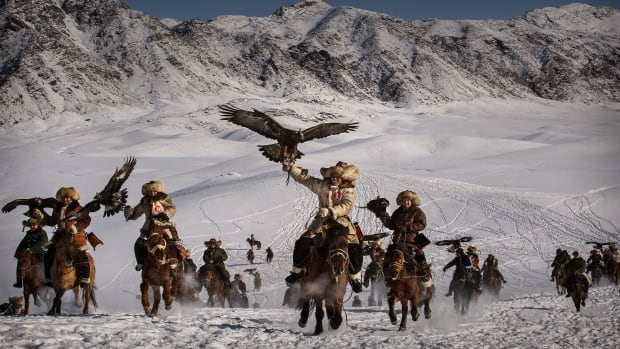 Kevin Frayer spent time with a Chinese Kazakh community last year to capture this incredible image of an annual festival featuring a traditional hunt with eagles. The event is held in the mountains of Qinghe County, Xinjiang, in northwestern China.