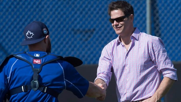 "Blue Jays GM Ross Atkins, seen here greeting catcher Russell Martin at spring training in Dunedin, Fla., on Tuesday, is remaining tight-lipped when it comes to Jose Bautista's contract negotiations and trade rumours involving fellow outfielder Michael Saunders. ""When it comes to a negotiation, a trade rumour, we are not going to discuss them publicly."""