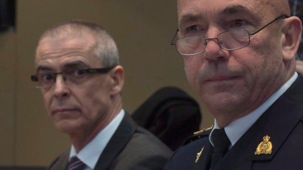 CSIS director Michel Coulombe (left) looks on as RCMP Commissioner Bob Paulson waits to appear before the Commons public safety and national security committee in Ottawa on Tuesday.