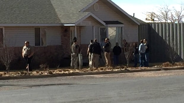 Law enforcement officers conduct a search at the Wedgewood Development construction company in Hildale, Utah, Tuesday. Police searched businesses in the polygamous town on the Utah-Arizona border, as 11 leaders of a polygamist sect were arrested for food stamp fraud.