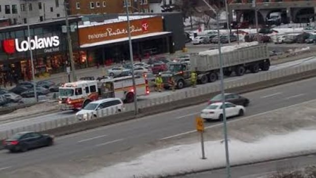 Emergency crews responded after a pedestrian was hit by a truck on Higway 417 during rush hour Tuesday afternoon. The man later died at hospital.