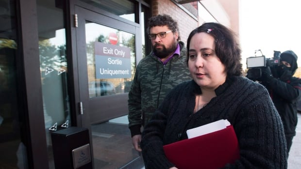 Jennifer Neville-Lake, right, and her husband Edward Lake arrive at the court house in Newmarket, Ont., on Tuesday.