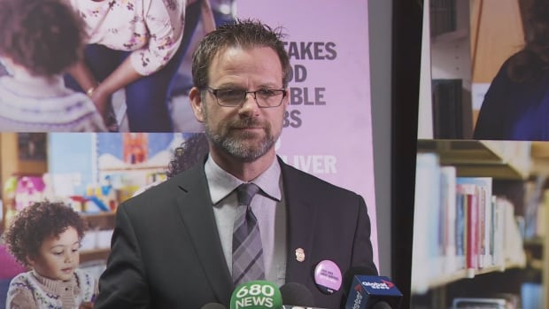 CUPE Local 79 president Tim Maguire updates the media at the Sheraton Centre on the status of bargaining with the city on Wednesday, the third day of the union's work-to-rule campaign.