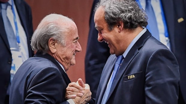 Sepp Blatter, left, and Michel Platini, had their soccer bans reduced from eight years to six by FIFA's appeal committee. They were banned in December over a 2 million Swiss franc ($2 million US) payment made by FIFA president Blatter to UEFA president Platini in 2011.