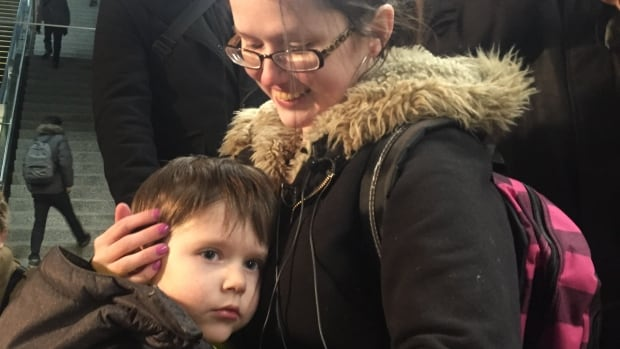 Brittni Petke clutches her young son Kayden after a scary separation on a C-Train station ended with the family reuniting.