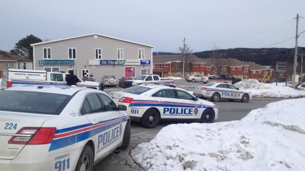 Residents say there were eight or nine police vehicles outside a building on Forbes Street Wednesday afternoon.
