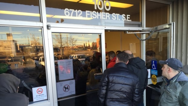 A lineup starts to form hours before an Alberta Works office opens as those in need compete for the few available appointments each day.