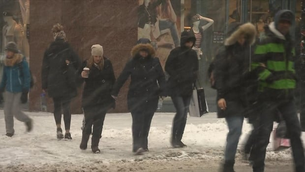 Pedestrians in Montreal tread carefully at icy, slushy intersections as snow turned to ice pellets on their commute home on Wednesday evening.