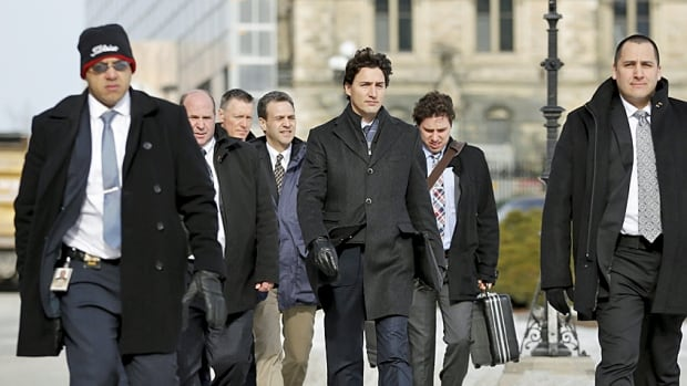 Prime Minister Justin Trudeau, with his security and staff, walks across Parliament Hill earlier this month. With budget day approaching, tougher decisions are being made.