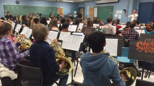Maestro Alexander Shelley conducting the Moncton Youth Orchestra at Edith Cavell School.