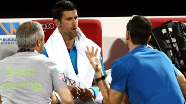 Novak Djokovic receives medical treatment at the Dubai Tennis Championships. Djokovic retired from his quarter-final match due to an eye infection, the first time in more than a year that he did not advance to a tournament final.