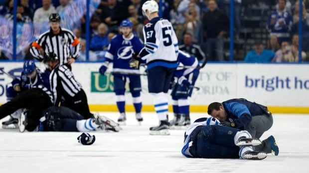 Winnipeg Jets' Bryan Little is attended to by a trainer after a hit from Tampa Bay Lightning's Anton Stralman, of Sweden, during the second period of an NHL hockey game Thursday, Feb. 18, 2016, in Tampa, Fla.