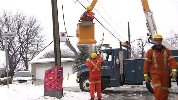 A Hydro-Québec crew works to restore power in Hudson, Quebec.