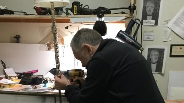 Mike Carroll of Grand Falls-Windsor converts a flute into a lamp stand.