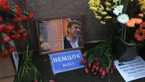 Fresh flowers at a memorial for Boris Nemtsov, a prominent opposition leader who was gunned down on a Moscow bridge on Feb. 27, 2015. A march will be held to commemorate the killing this Saturday. Opposition activists tried to get the name of the bridge changed to Nemtsov Bridge, which is what it says on the blue sign, but Moscow authorities refused.