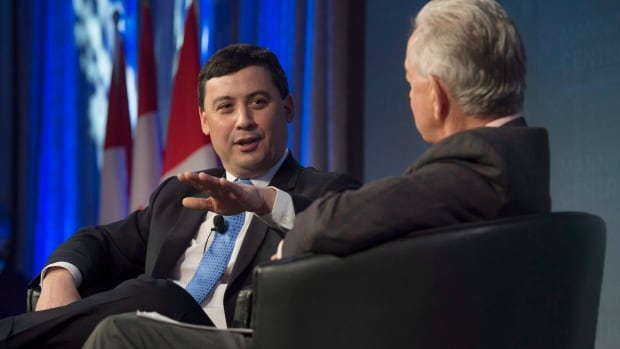 Michael Chong, left, speaks with Preston Manning during a session entitled 'If I run, here's how I'd do it' at the Manning Centre's conservative conference in Ottawa on Friday.
