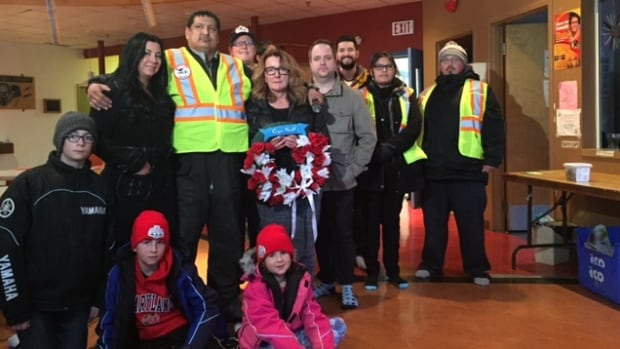 Members of the Nemeth family stand with members of the Bear Clan, a North End street patrol that helped search for Cooper Nemeth. The 17-year-old was missing for about a week before his body was found in a trash bin on Feb. 20.