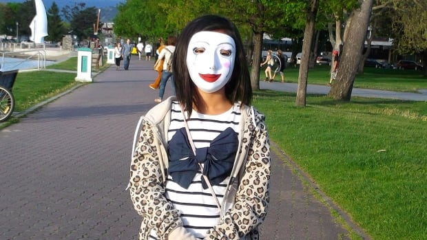 This photo of a woman in a mask is one of the photos on display at the Alternator Centre for Contemporary Art in Kelowna until Mar. 5. The photo was taken by an immigrant to Kelowna.