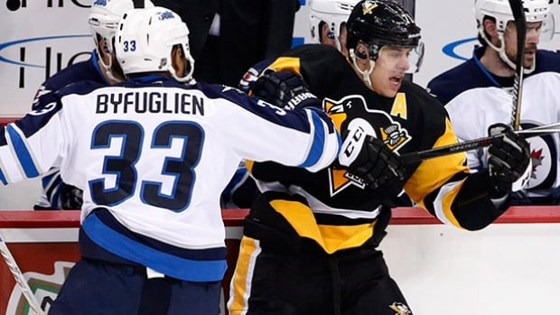 Winnipeg Jets defenceman Dustin Byfuglien collides with Pittsburgh Penguins forward Evgeni Malkin during the first period in Pittsburgh on Saturday.