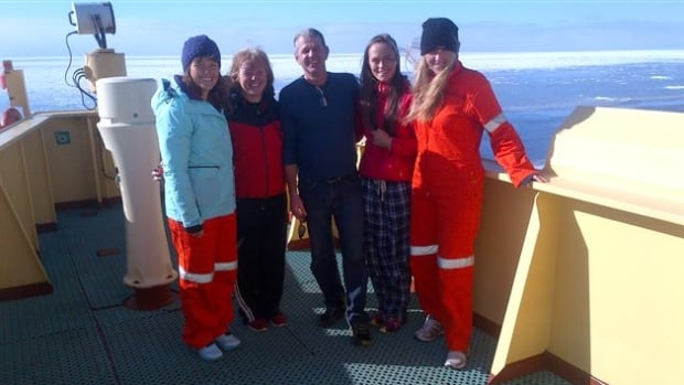 Rescued rowing crew members Jane McIntosh, Clare Lanyon, Olivia Wilson and Gemma Chalk pose with Rio Grita's captain, Richard Tremblay.