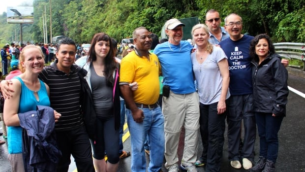 Della Magnusson, a nurse (fourth from right) was among a group of people who provided first aid at a crash scene in Ecuador in February of 2015.