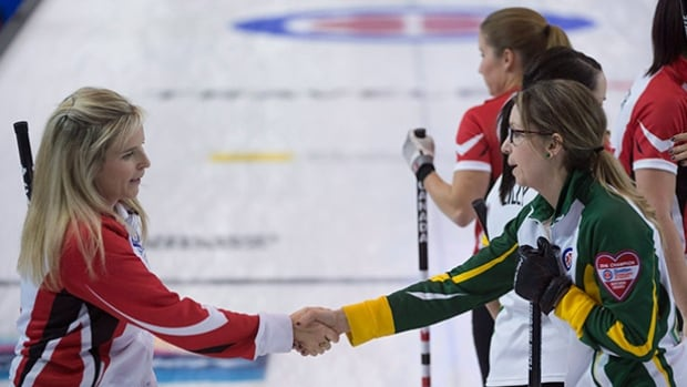 Northern Ontario skip Krista McCarville, right, shakes hands with Team Canada skip Jennifer Jones after beating team Canada during the semifinal and advancing to the gold medal game at the Scotties Tournament of Hearts in Grande Prairie, Alta on Saturday.