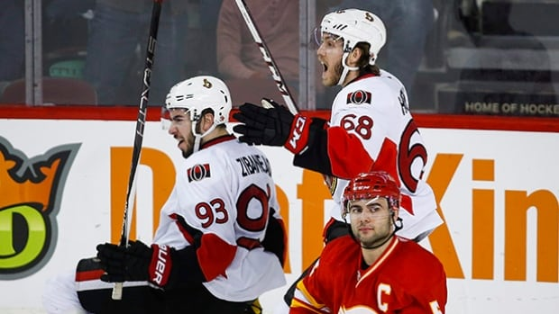 Ottawa Senators' Mika Zibanejad, left, scored a hat trick in 2:38 to lead his team past the Calgary Flames in a 6-4 victory.
