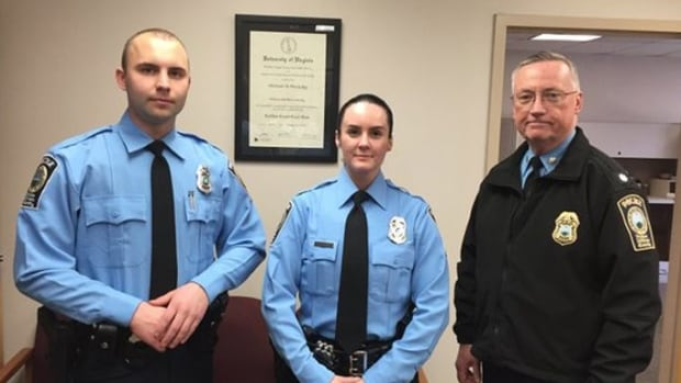 Officer Ashley Guindon, centre, is flanked by fellow rookie Officer Steven Kendall, left, and Lt. Col. Barry Bernard, deputy chief of the Prince William County, Va., Police Department. Guindon was shot and killed on Saturday while attending a domestic violence call. It was her first day on the job.