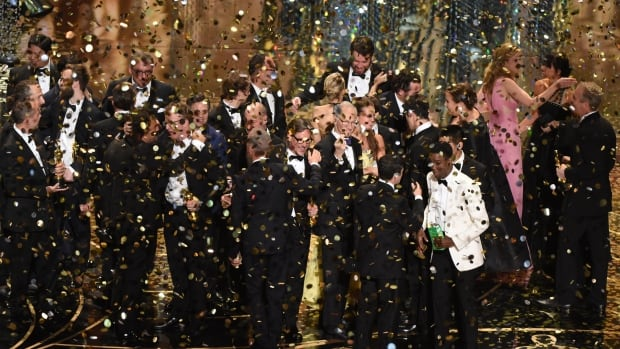 The production team and cast of Spotlight celebrate the award for Best Picture on stage at the 88th Oscars last night.