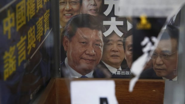 A book featuring a photo of Chinese President Xi Jinping and other officials on the cover, is showed at the entrance of the closed Causeway Bay Bookstore which is known for titles about Chinese political scandals and other sensitive issues.